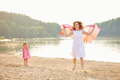 Mother with daughter in summer at lake Stock Photo