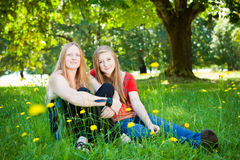 Mother and daughter in summer nature. Mother and daughter in green summer nature. Shallow DOF, girls face in focus Stock Images