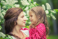Mother and daughter in summer park Stock Photography