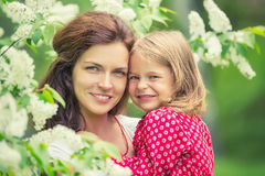 Mother and daughter in summer park Stock Photo