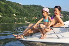 Mother daughter sunbathing on cutter Royalty Free Stock Images