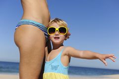 Mother and daughter with sunglasses on the beach Stock Images