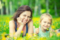 Mother and daughter on sunny meadow Royalty Free Stock Photography
