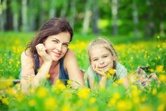 Mother and daughter on sunny meadow Stock Photography