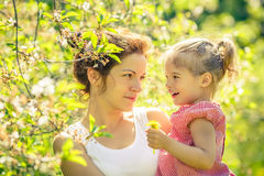 Mother and daughter in sunny park Stock Photo