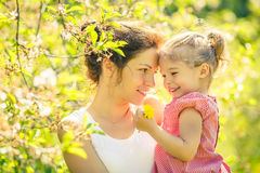 Mother and daughter in sunny park Stock Photos