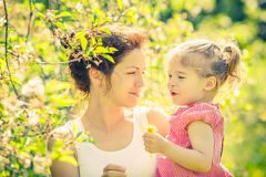 Mother and daughter in sunny park Stock Photography