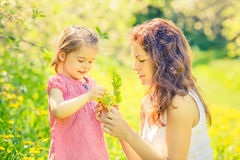 Mother and daughter in sunny park Royalty Free Stock Photo