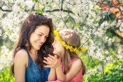 Mother and daughter in sunny park Royalty Free Stock Image