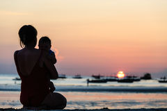 Mother and daughter on sunset beach Royalty Free Stock Image