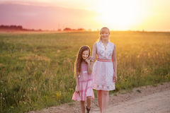 Mother and daughter at sunset Stock Images