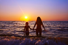 Mother and daughter at sunset Royalty Free Stock Images