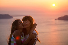 Mother and daughter at sunset. stock photos