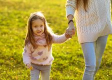 Mother daughter at sunset playing, Mothers Day. stock image