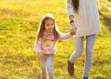 Mother daughter at sunset playing, Mothers Day. royalty free stock photo