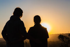 Mother Daughter Sunset Silhouetted Stock Photo