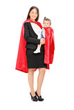 Mother and daughter in superhero costumes Royalty Free Stock Photo