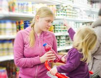Mother and daughter in supermarket Stock Photo