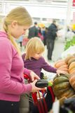 Mother and daughter in supermarket Stock Images