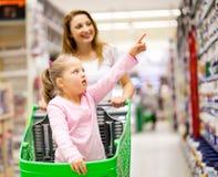 Mother daughter supermarket Stock Photos