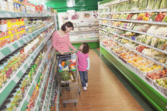 Mother and Daughter in Supermarket Shopping royalty free stock image