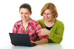 Mother and daughter surf internet using laptop Stock Images