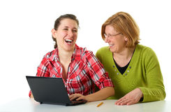 Mother and daughter surf internet using laptop Royalty Free Stock Image