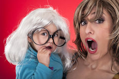 Mother and daughter are surprised at the same time Stock Images