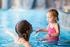 Mother and daughter at swimming pool Stock Image