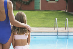 Mother And Daughter In Swimwear By Pool Stock Images