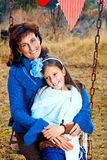 Mother and daughter on the swing stock photography