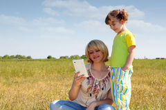 Mother and daughter with tablet Stock Image