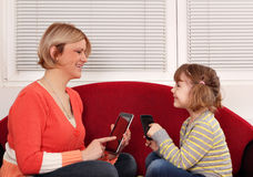 Mother and daughter with tablet Royalty Free Stock Photos