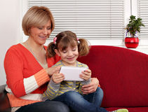 Mother and daughter with tablet pc family scene Royalty Free Stock Photo