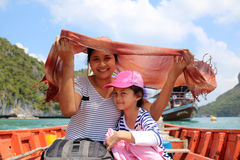 Mother and daughter take a boat trip around the islands. Royalty Free Stock Image