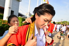 Mother and daughter. Mother take the overcoat for daughter on commencement day,  Thailand university Royalty Free Stock Photos