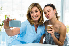 Mother and daughter take selfie Stock Photo