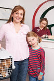 Mother And Daughter Taking Cat To Vet Stock Photo