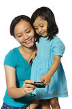 Mother And Daughter Taking Own Photograph Stock Image