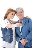 Mother and daughter taking photo of themselves Royalty Free Stock Image