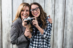 Mother and daughter taking a picture Royalty Free Stock Image
