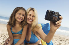 Mother And Daughter Taking Self Portrait On Beach Royalty Free Stock Image