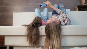 Mother and daughter taking self portrait stock footage