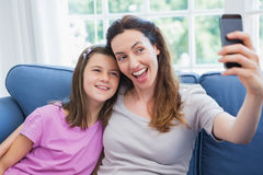 Mother and daughter taking a selfie Royalty Free Stock Image