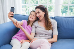 Mother and daughter taking a selfie Royalty Free Stock Images