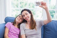 Mother and daughter taking a selfie Royalty Free Stock Photos