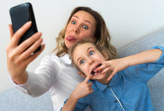 Mother and daughter taking selfie. Royalty Free Stock Photography