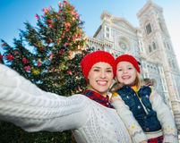 Mother and daughter taking selfie near Christmas tree, Florence Royalty Free Stock Images