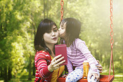 Mother and daughter taking selfie photo Royalty Free Stock Image