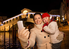 Mother and daughter taking selfie with smartphone in Venice Royalty Free Stock Images